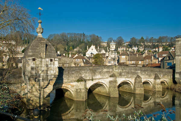 The old medieval town bridge across the River Avon at Bradford-on-Avon. The peculiar building built into the bridge was once a toll booth, and later served as a lock-up, or gaol.